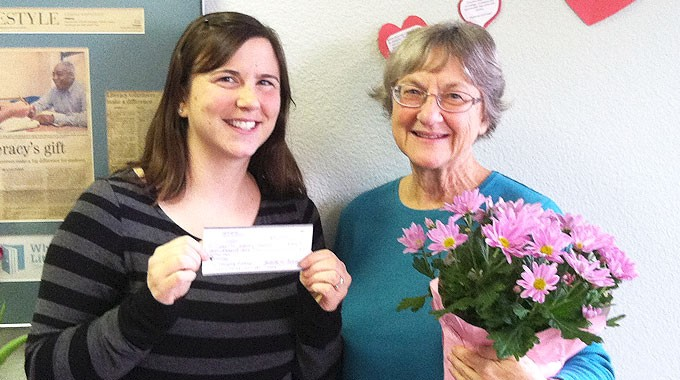 Summer Accepts Donation From Judith Culver.