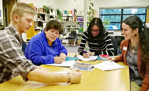 Classroom tutors working with adult learners.