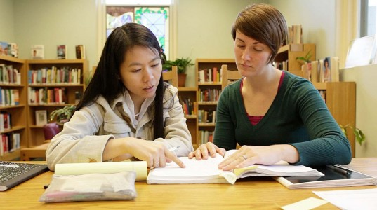 Tutor working with an English Language Learner.